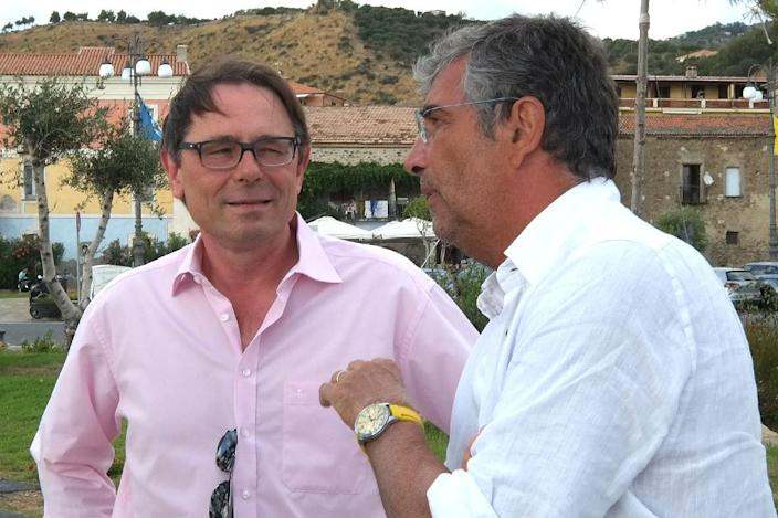 Salvatore Di Somma (R), Professor of Internal Medicine at Rome's Sapienza University and Andreas Bergmann, biochemist, CEO of Sphingotec GMBH, seen during an interview in Acciaroli, southern Italy, on August 23, 2016 (AFP Photo/Mario Laporta)