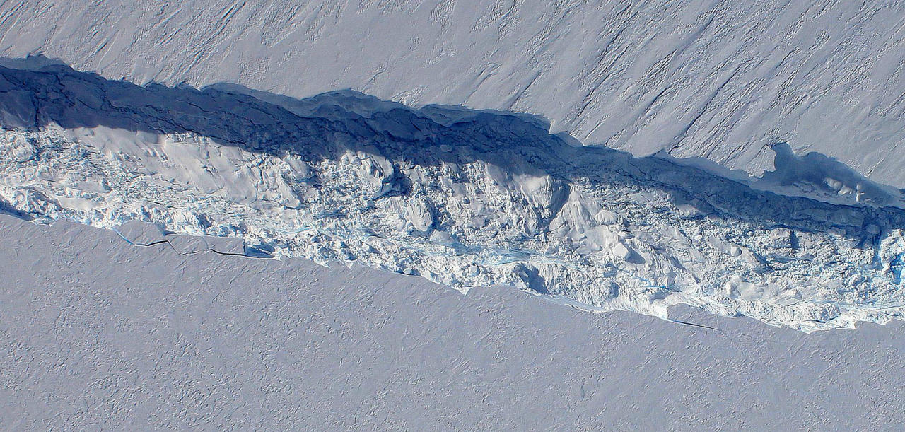 A close-up view of the crack spreading across the ice shelf of Pine Island Glacier shows the details of the boulder-like blocks of ice that fell into the rift when it split, from this handout image captured by the Digital Mapping System (DMS) aboard NASA's DC-8 October 26, 2011. Scientists expect the crack, 18 miles (29 km) in length, to propagate and the ice shelf to calve an iceberg of more than 300 square miles (483 square km) in the coming months. Picture taken October 26, 2011. REUTERS/NASA/DMS/Handout
