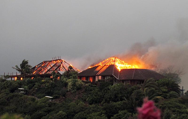 In this image  issued  Monday Aug. 22, 2011 by Virgin Limited Edition shows British entrepreneur's  Sir Richard Branson's luxury home, on Necker Island, in the Caribbean, in flames as a fire which ripped through the luxury home. Guests including Academy Award-winning actress Kate Winslet escaped uninjured when fire destroyed Richard Branson's Caribbean home during a tropical storm Monday, said the British businessman. The Virgin Group boss said about 20 people, including Winslet and her children, were staying in the eight-bedroom Great House on Necker, his private isle in the British Virgin Islands. (AP Photo/Virgin Limited Edition/PA) UNITED KINGDOM OUT NO SALES NO ARCHIVE EDITORIAL USE ONLY