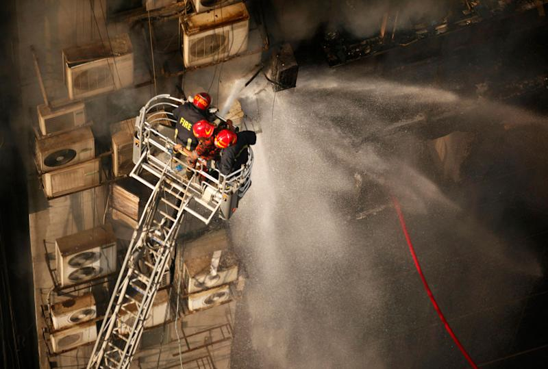 Firefighters work to douse a fire in a multi-storied office building in Dhaka, Bangladesh, March 28, 2019. (AP Photo/Mahmud Hossain Opu)