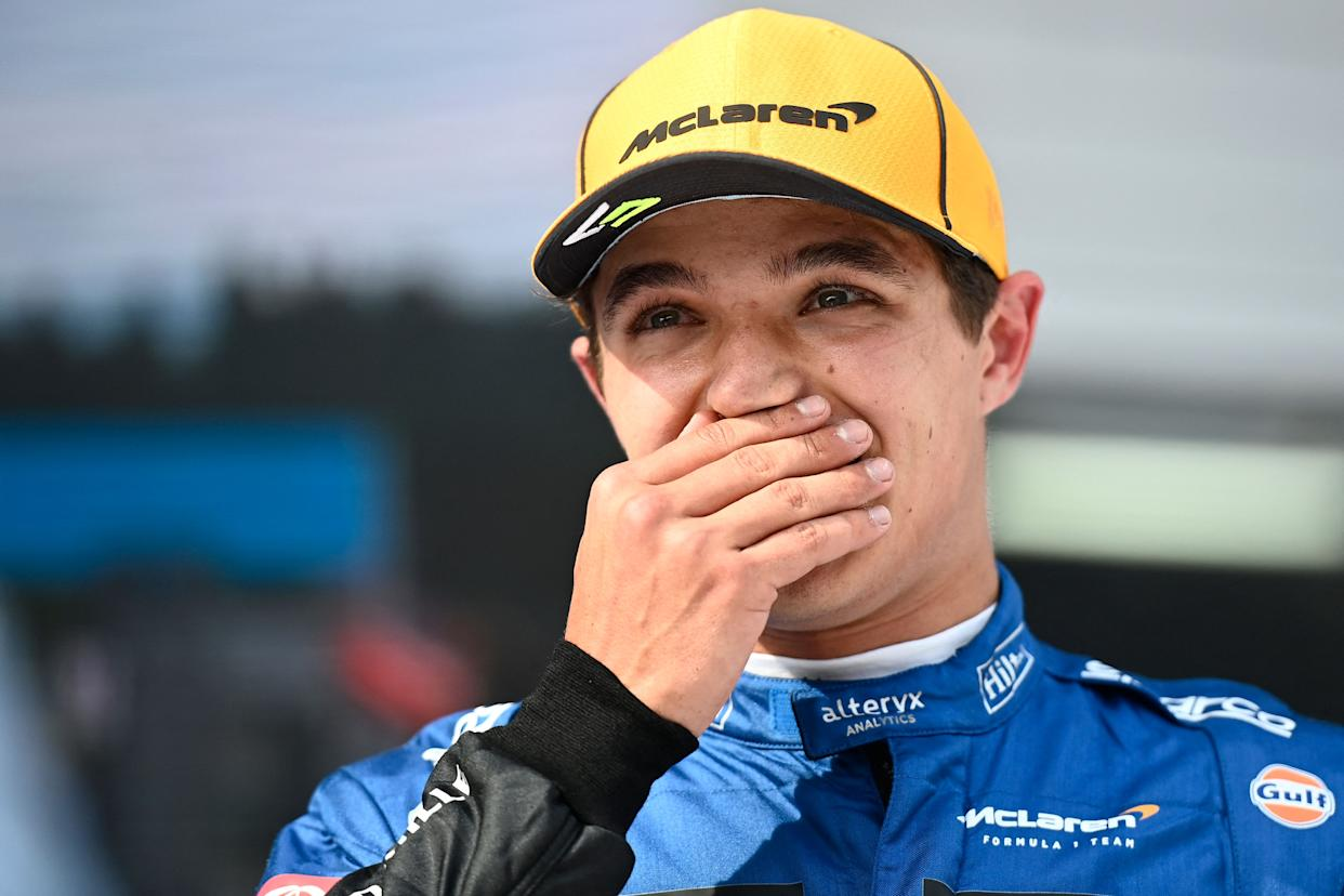 Third place McLaren's British driver Lando Norris reacts on the podium after the Formula One Austrian Grand Prix at the Red Bull Ring race track in Spielberg, Austria, on July 4, 2021. (Photo by CHRISTIAN BRUNA / POOL / AFP) (Photo by CHRISTIAN BRUNA/POOL/AFP via Getty Images)