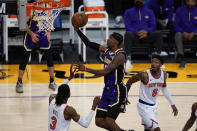 Los Angeles Lakers guard Kentavious Caldwell-Pope (1) shoots against New York Knicks center Nerlens Noel (3) and guard Elfrid Payton (6) during the first quarter of a basketball game Tuesday, May 11, 2021, in Los Angeles. (AP Photo/Ashley Landis)