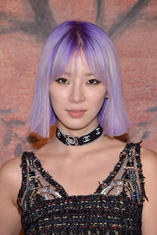 <p>The social media star and Estée Lauder global beauty contributor's unicorn-purple hair is oh so dreamy. Simple black winged liner and pale pink lipstick complete this look. (Photo: Getty Images) </p>
