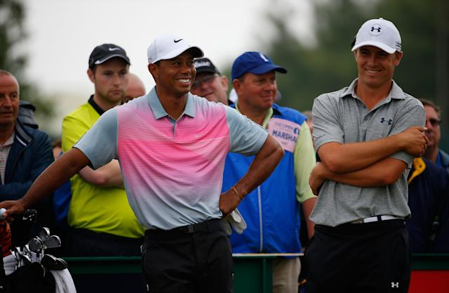HOYLAKE, ENGLAND - JULY 19: Tiger Woods of the United States shares a joke with Jordan Spieth of the United States (R) during the third round of The 143rd Open Championship at Royal Liverpool on July 19, 2014 in Hoylake, England. (Photo by Tom Pennington/Getty Images)