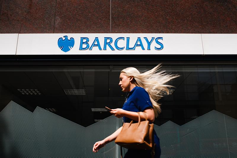 A woman walks past a branch of Barclays bank on Wormwood Street in London, England, on July 26, 2019. Four major UK banks, including Barclays, are set to release interim figures over the coming days. Half-year results for Lloyds Banking Group are due out on July 31, for Barclays on August 1, for the Royal Bank of Scotland (RBS) on August 2 and for HSBC on August 5. (Photo by David Cliff/NurPhoto via Getty Images)