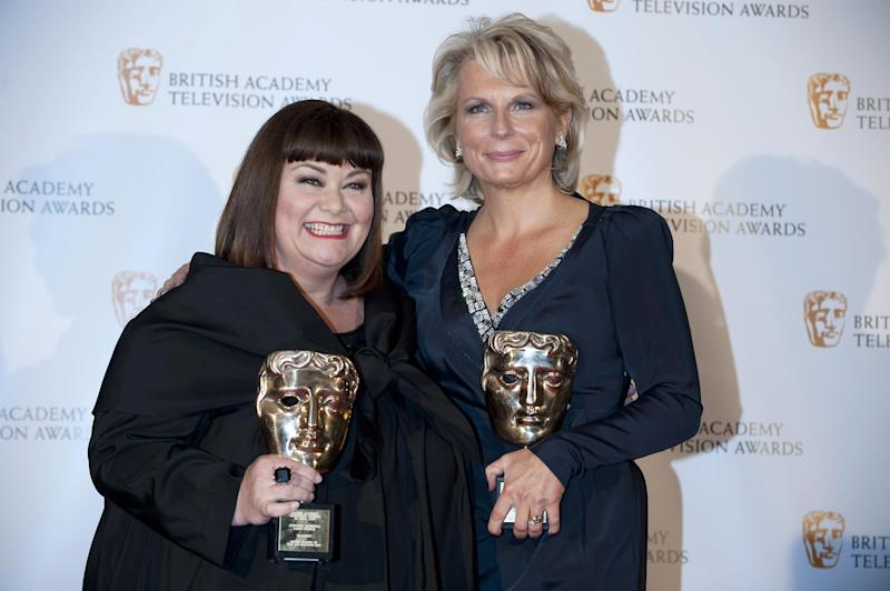 British actress Dawn French (L) and Jennifer Saunders (R) pose with their Fellowship British Academy Television Award (BAFTA) in Central London on April 26, 2009. AFP PHOTO/Ben Stansall (Photo credit should read BEN STANSALL/AFP/Getty Images)