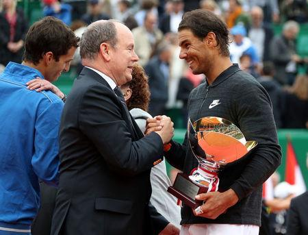 Tennis - Monte Carlo Masters - Monaco - 23/04/17 - Prince Albert II of Monaco shakes hand with Rafael Nadal of Spain after winning his final tennis match against his compatriot Albert Ramos-Vinolas (L) at the Monte Carlo Masters. REUTERS/Eric Gaillard