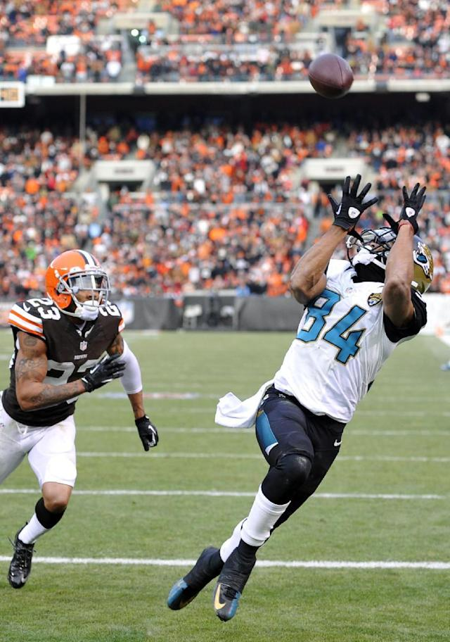 Jacksonville Jaguars wide receiver Cecil Shorts (84) catches a 20-yard touchdown pass against Cleveland Browns cornerback Joe Haden (23) in the fourth quarter of an NFL football game on Sunday, Dec. 1, 2013 in Cleveland. The score gave the Jaguars a 32-28 win over the Browns. (AP Photo/David Richard)