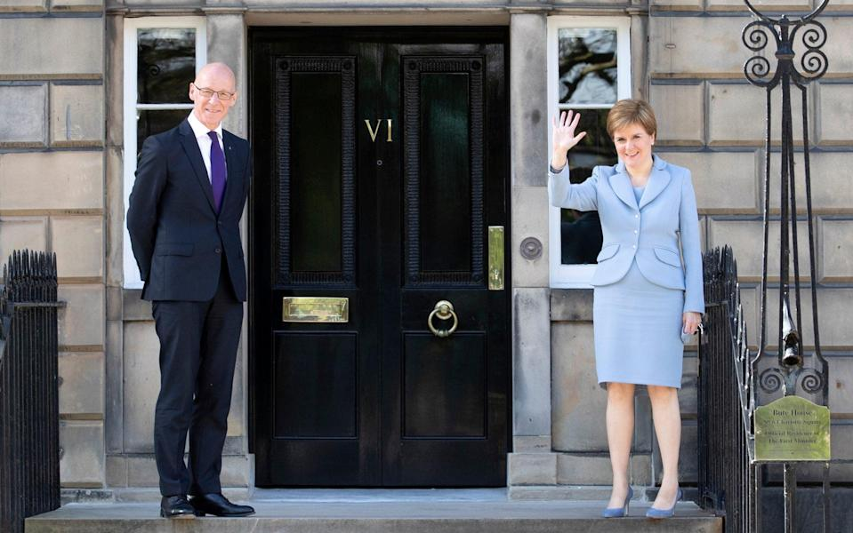 John Swinney, left, and Nicola Sturgeon will make a decision this week - Pool/Getty Images Europe
