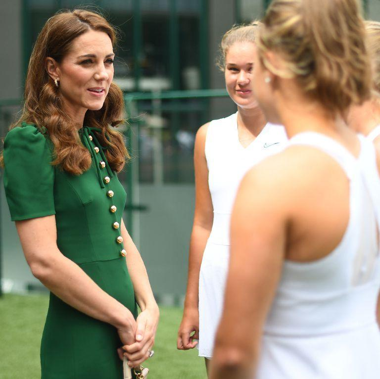 <p>The two women traveled to Wimbledon separately. Kate arrived early for a lunch with club members. Here she is speaking with junior players ahead of the women's final. She chose to re-wear a rich green Dolce and Gabbana dress for today's event.</p>