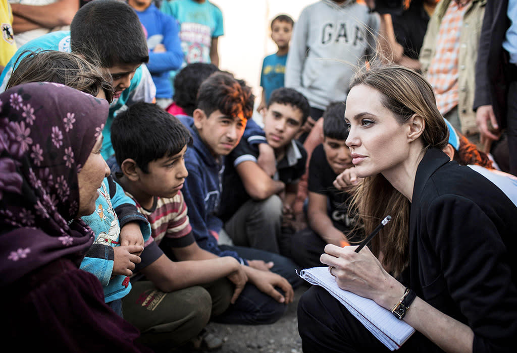North America Rights Only-Jordan, Jordan - 6/18/13-US actress Angelina Jolie listening to Syrian refugees in a Jordanian military camp based the the Jordan-Syria border on June 18, 2013. 
