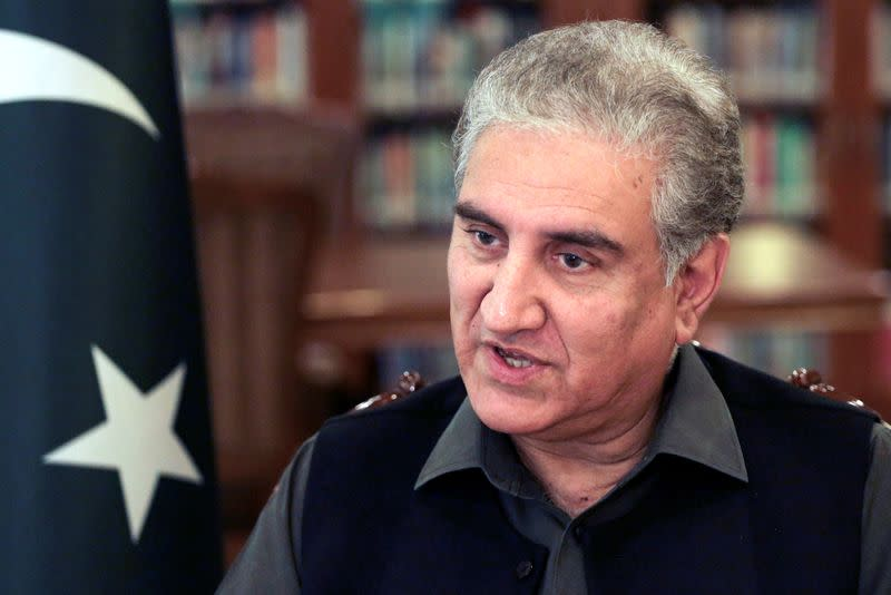 FILE PHOTO: Pakistan's Foreign Minister Shah Mehmood Qureshi speaks during an interview with Reuters at the Ministry of Foreign Affairs office in Islamabad