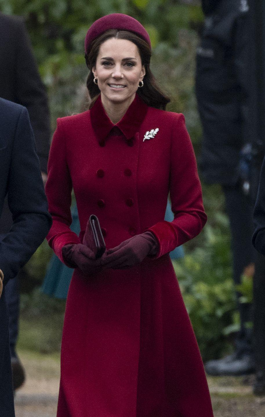 <p>Burgundy must be a royal fave, 'cause Kate wore this merlot coat and matching hat for Christmas in Sandringham. P.S. Those gloves. I want. </p>