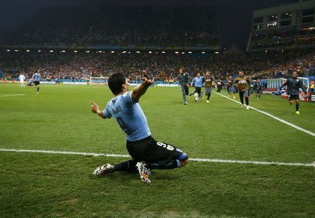Uruguay's Luis Suarez celebrates after winning the 2014 World Cup Group D soccer match between Uruguay and England at the Corinthians arena