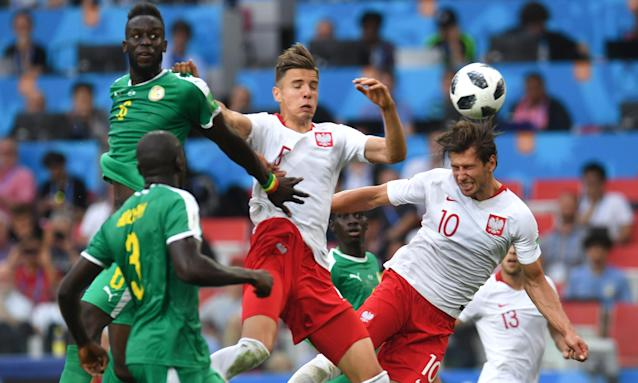 Poland's Grzegorz Krychowiak (right) heads home from a free-kick in their defeat against Senegal.