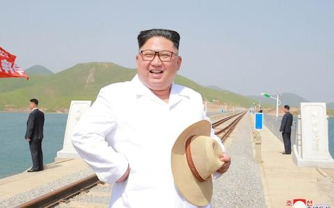 North Korean leader Kim Jong Un inspects the completed railway that connects Koam and Dapchon, in this undated photo released by North Korea's Korean Central News Agency - Credit: Reuters