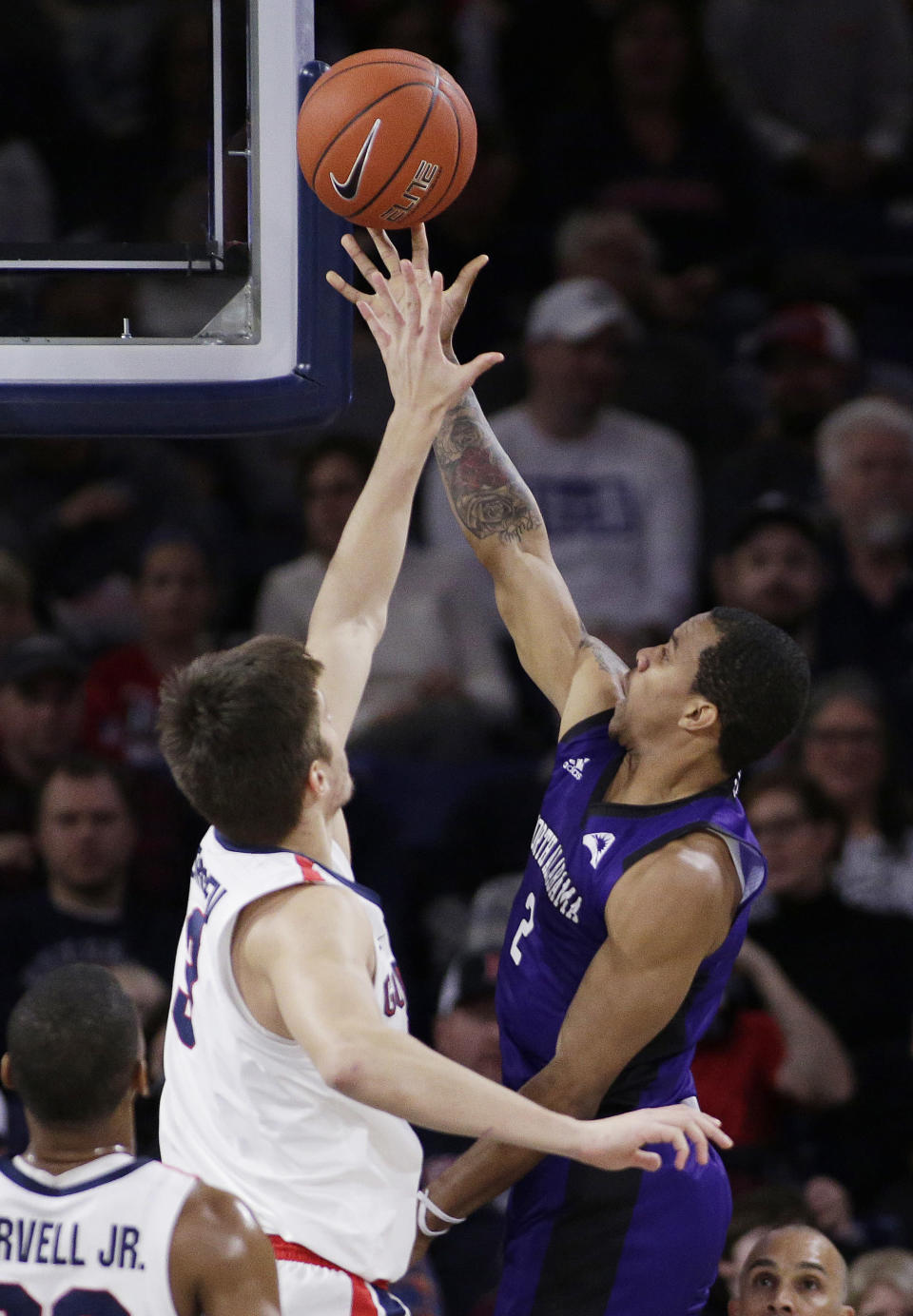 North Alabama guard Christian Agnew (2) shoots while defended by Gonzaga forward Filip Petrusev during the first half of an NCAA college basketball game in Spokane, Wash., Friday, Dec. 28, 2018. (AP Photo/Young Kwak)