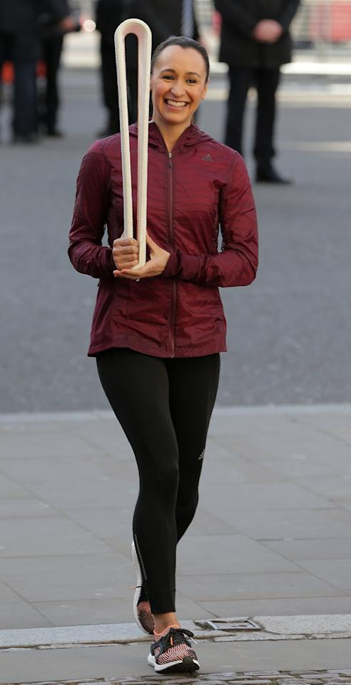 Great Britain's Olympic athlete Jessica Ennis-Hill carries the relay baton for the XX1 Commonwealth Games to be held on Australia's Gold Coast next year, as she arrives to attend a Commonwealth Day Service at Westminster Abbey in central London, on March 13, 2017.Queen Elizabeth II has been Head of the Commonwealth throughout her reign. Organised by the Royal Commonwealth Society, the Service is the largest annual inter-faith gathering in the United Kingdom. (AFP Photo/Daniel LEAL-OLIVAS)