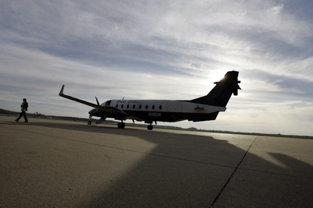 A pilot for Great Lakes Airlines walks away from her plane after landing at Cape Girardeau (Mo.) Regional Airport on March 25, 2009. (Photo: Jeff Roberson/AP)
