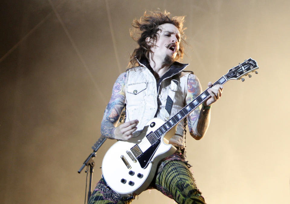 Musician Justin Hawkins of the British band The Darkness performs on stage at the Nova Rock music festival in Nickelsdorf, some 70 kilometres (44 miles) east of Vienna, June 11, 2011. Nova Rock is Austria's largest rock festival which takes place from June 11 to June 13, 2011.  REUTERS/Lisi Niesner  (AUSTRIA - Tags: ENTERTAINMENT)