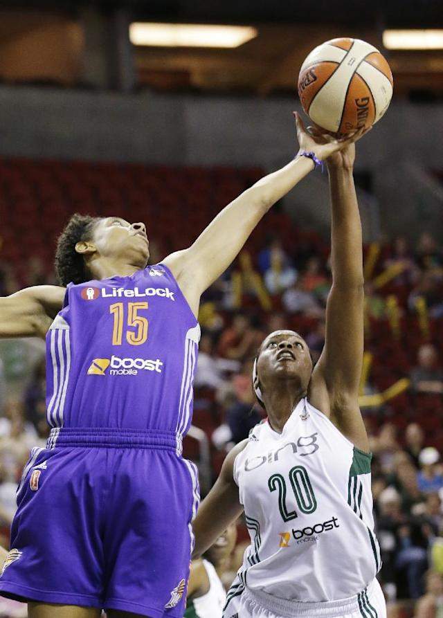 Seattle Storm's Camille Little (20) and Phoenix Mercury's Briana Gilbreath reach for a rebound in the first half of a WNBA basketball game on Thursday, Aug. 1, 2013, in Seattle. (AP Photo/Elaine Thompson)