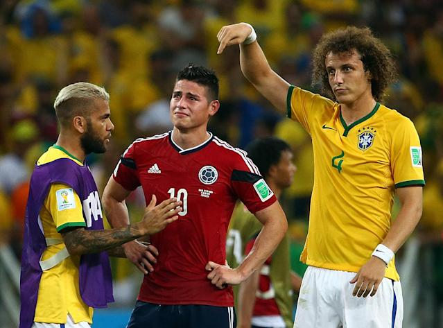 David Luiz and Dani Alves console a heartbroken James Rodriguez after Brazil's 2014 World Cup quarterfinal victory over Colombia. (Getty)