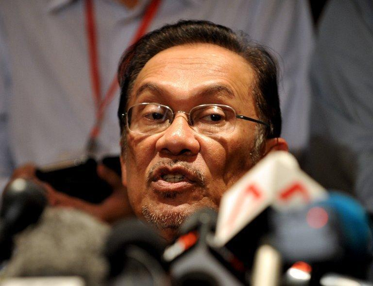 Opposition leader Anwar Ibrahim speaks during a press conference in Penang on May 6, 2013. A planned wave of protests over disputed Malaysian elections is the most provocative challenge to the government in years, upping pressure on a long-ruling regime already smarting from the polls