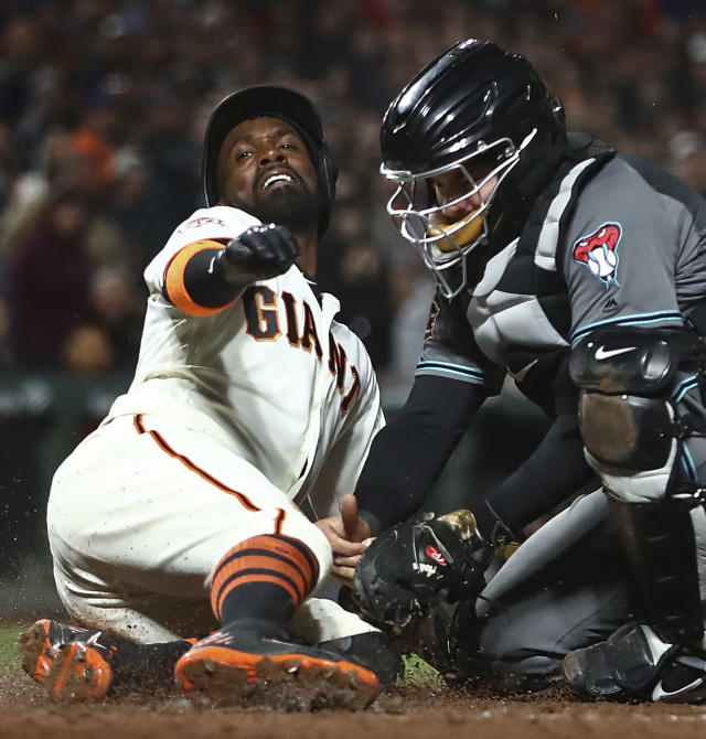Arizona Diamondbacks catcher Alex Avila, right, tags out San Francisco Giants' Andrew McCutchen during the sixth inning of a baseball game Tuesday, April 10, 2018, in San Francisco. McCutchen attempted to score on a hit by Brandon Crawford. (AP Photo/Ben Margot)