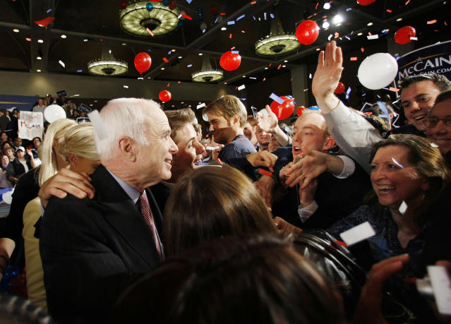<p>Republican presidential hopeful, Sen. John McCain, R-Ariz., and his wife Cindy greet supporters at his primary election watch party in Dallas, March 4, 2008. (Photo: Gerald Herbert/AP) </p>
