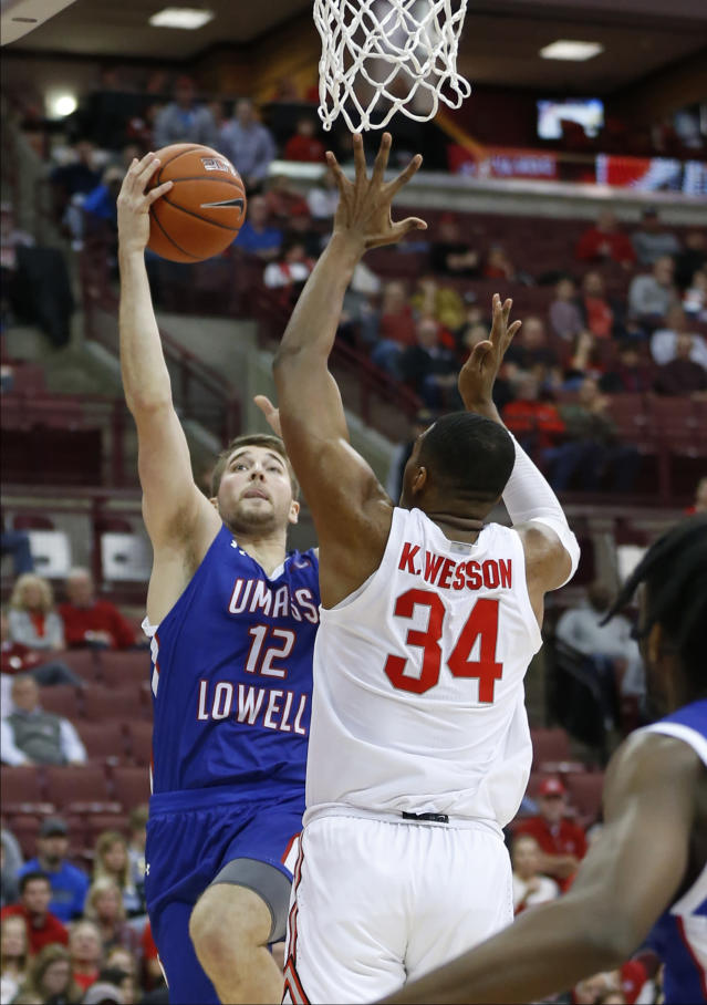 Massachusetts-Lowell's Josh Gantz, left, shoots over Ohio State's Kaleb Wesson during the first half of an NCAA college basketball game Sunday, Nov. 10, 2019, in Columbus, Ohio. (AP Photo/Jay LaPrete)