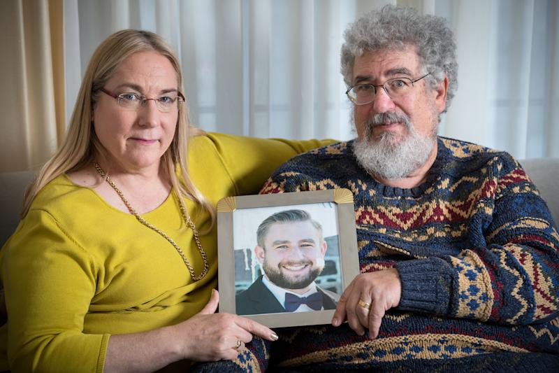 Mary Rich and her husband, Joel Rich hold a photo of their son, Seth Rich in their home in Omaha, Nebraska in 2017. (Photo: Matt Miller for The Washington Post via Getty Images)