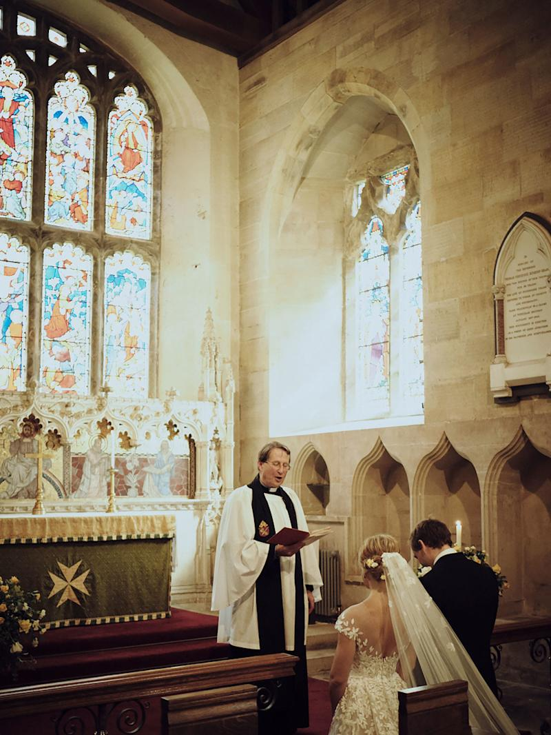 Kneeling at the altar for the Lord's Prayer with the light streaming through the medieval stained glass windows