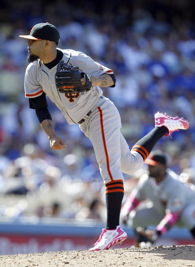 San Francisco Giants relief pitcher Sergio Romo throws against the Los Angeles Dodgers in the ninth inning of a baseball game on Sunday, May 11, 2014, in Los Angeles. (AP Photo/Alex Gallardo)
