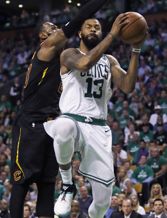 Boston Celtics forward Marcus Morris (13) goes to the basket against Cleveland Cavaliers forward LeBron James during the third quarter of Game 5 of the NBA basketball Eastern Conference finals Wednesday, May 23, 2018, in Boston. (AP Photo/Charles Krupa)