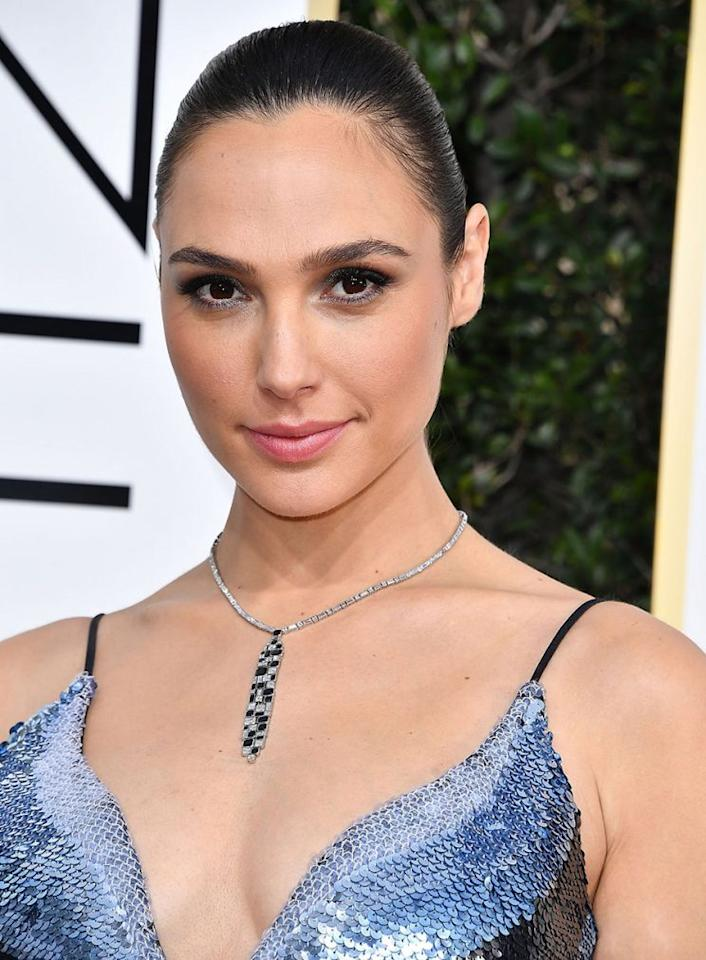 <p>While Gal Gadot went with clean, simple, and chic makeup at the 2017 Golden Globe Awards, it was her two-stranded power pony that really commanded all the attention. (Photo by Steve Granitz/WireImage)</p>