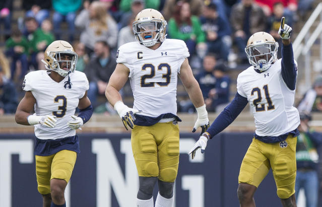Notre Dame's Jalen Elliott (21) celebrates an interception with teammates Houston Griffith (3) and Drue Tranquill (23) during the Notre Dame Blue-Gold Spring college football game Saturday, April 21, 2018, inside Notre Dame Stadium in South Bend, Ind. (Robert Franklin/South Bend Tribune via AP)