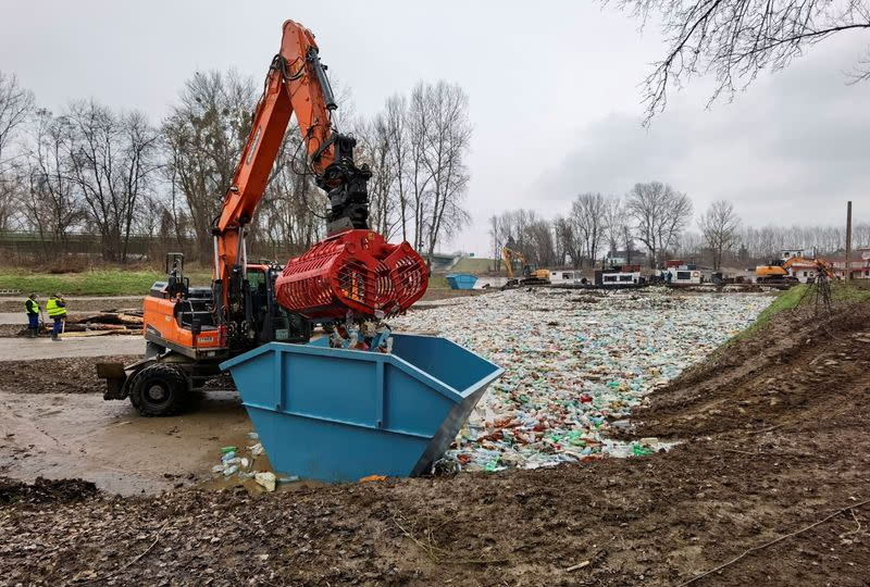 Workers collect plastic waste from Tisza river in Vasarosnameny