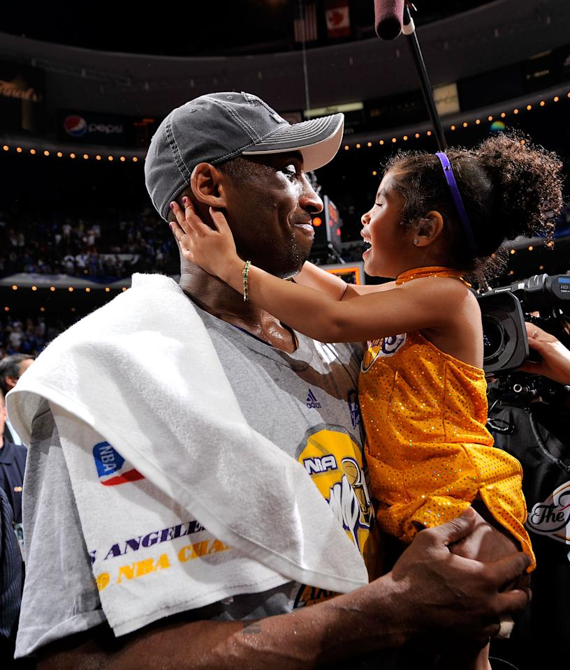 Kobe Bryant celebrates daughter Gianna after the Lakers won 99-86 to win the NBA Championship against the Orlando Magic in Game Five of the 2009 NBA Finals at Amway Arena on June 14, 2009 in Orlando, Florida. (Photo by Jesse D. Garrabrant/NBAE via Getty Images)