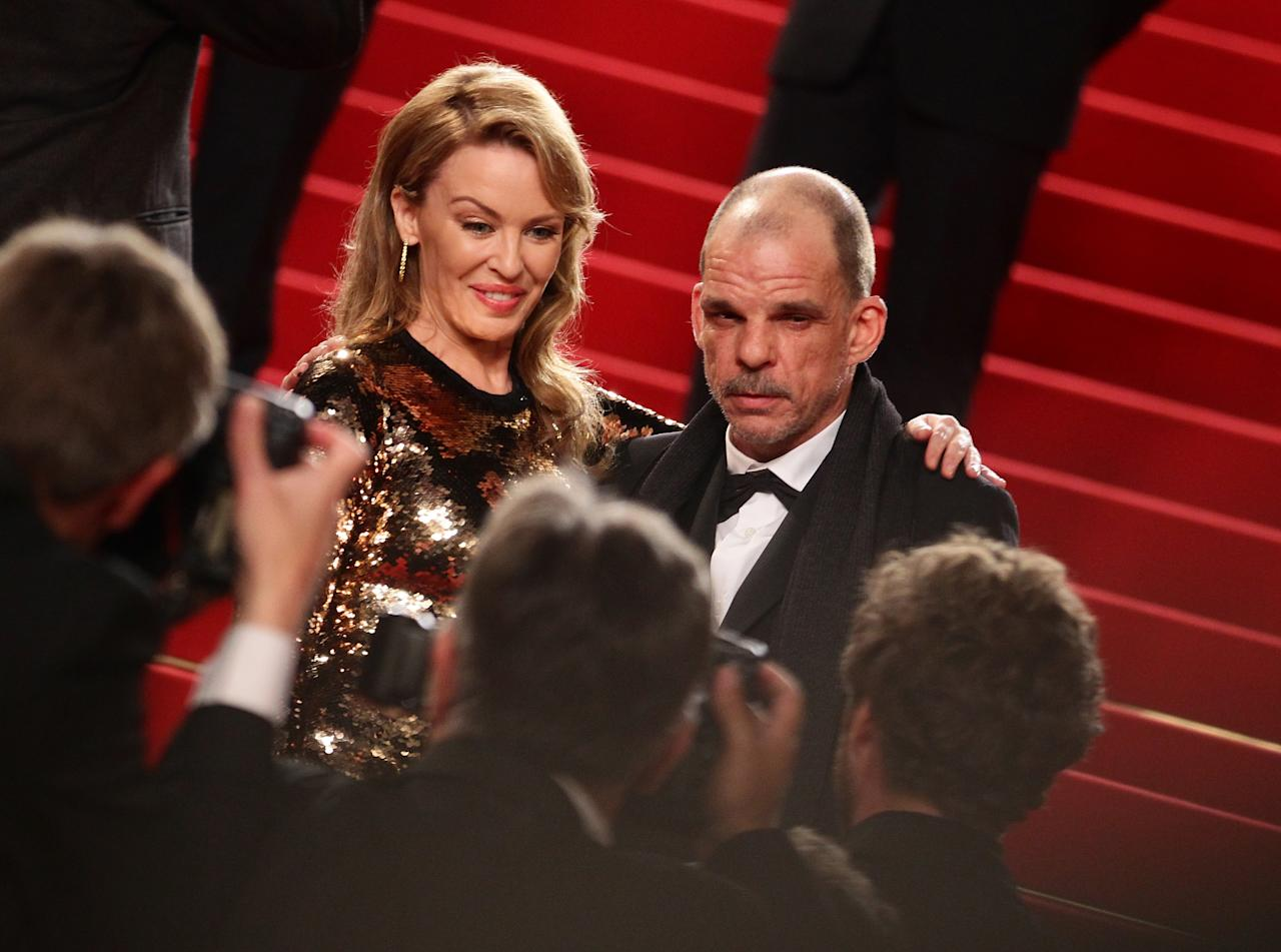 "CANNES, FRANCE - MAY 23:  Actors Kylie Minogue and Denis Lavant attend the ""Holy Motors"" Premiere during the 65th Annual Cannes Film Festival at Palais des Festivals on May 23, 2012 in Cannes, France.  (Photo by Vittorio Zunino Celotto/Getty Images)"