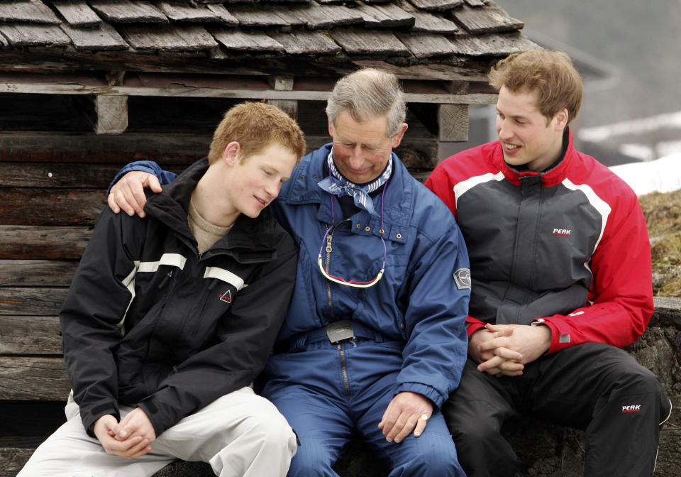 HRH Prince Charles poses with his sons Prince William (R) and Prince Harry (L) during the Royal Family's ski break at Klosters on March 31, 2005 in Switzerland.