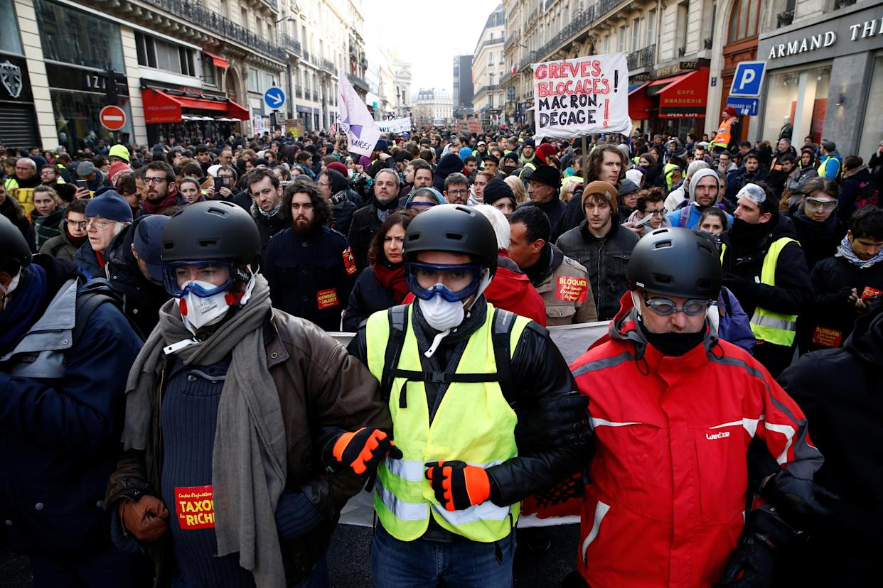 Protesters wearing yellow vests at a demonstration against French President <span>Emmanuel</span>Macron in Paris on Saturday. (Photo: Stephane Mahe/Reuters)