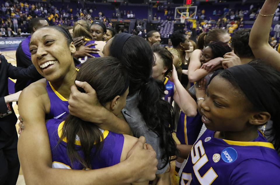 LSU forward Sheila Boykin, left, and her teammates celebrate their winning the NCAA college basketball second-round tournament game against West Virginia, 76-67, Tuesday, March 25, 2014, in Baton Rouge, La. (AP Photo/Rogelio V. Solis)
