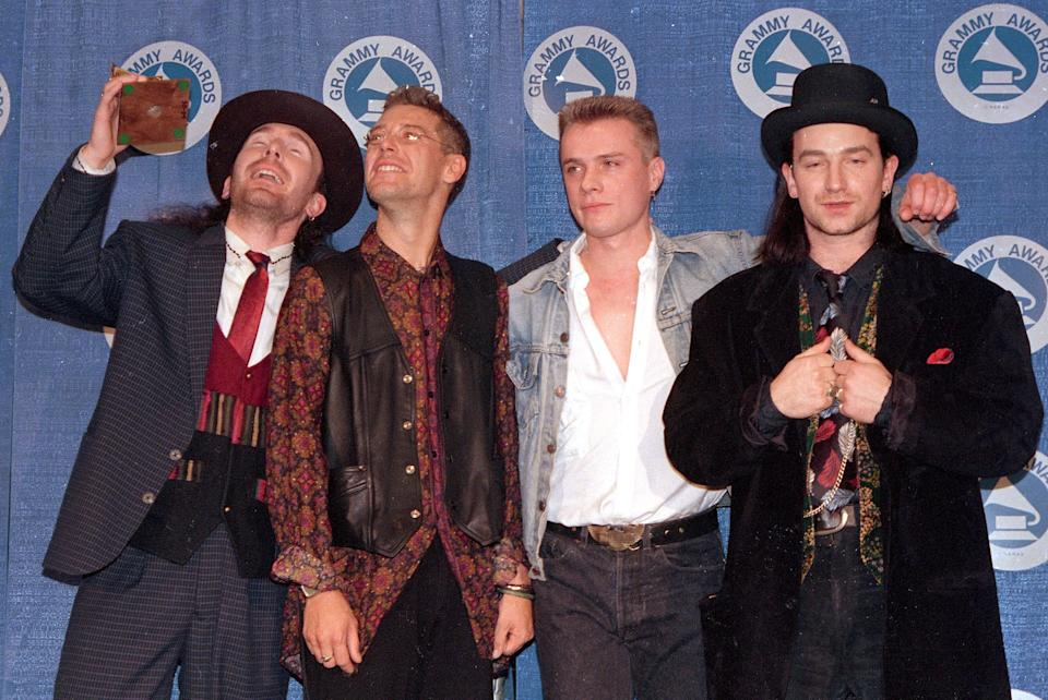"The Irish rock group U2 wins a Grammy for album of the year, ""The Joshua Tree,"" at the Grammy Awards ceremony at New York's Radio City Music Hall, March 2, 1988. The band members, from left, are, The Edge, Adam Clayton, Larry Mullen and Bono. (AP Photo/Mark Lennihan)"