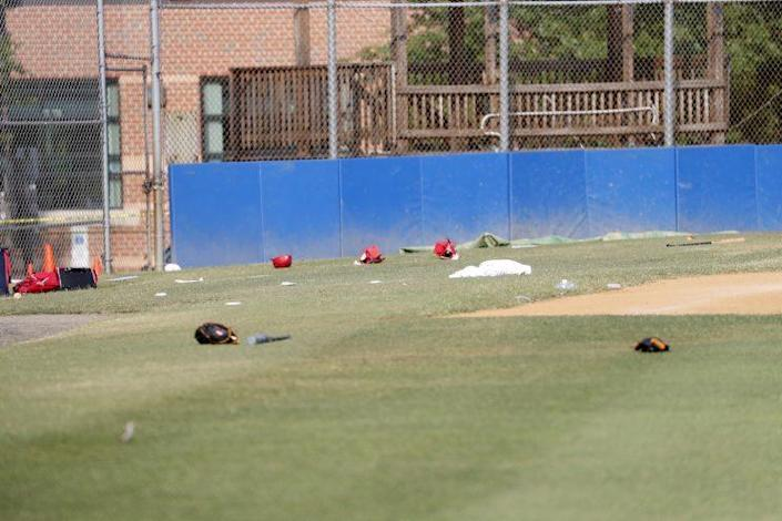 Baseball equipment is seen scattered on the field where a shooting took place at the practice of the Republican congressional baseball team at Eugene Simpson Stadium Park in Alexandria, Va, June 14, 2017. (Shawn Thew/EPA)
