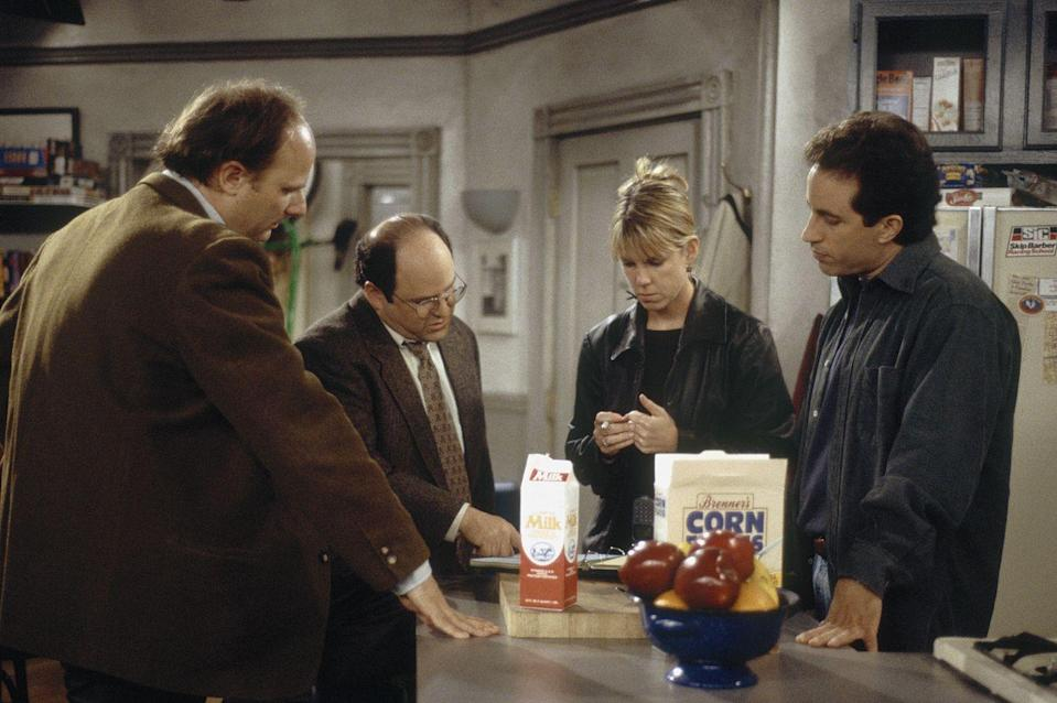 <p>Alexander and Seinfeld go over notes with director Andy Ackerman and a crew member in-between takes. </p>