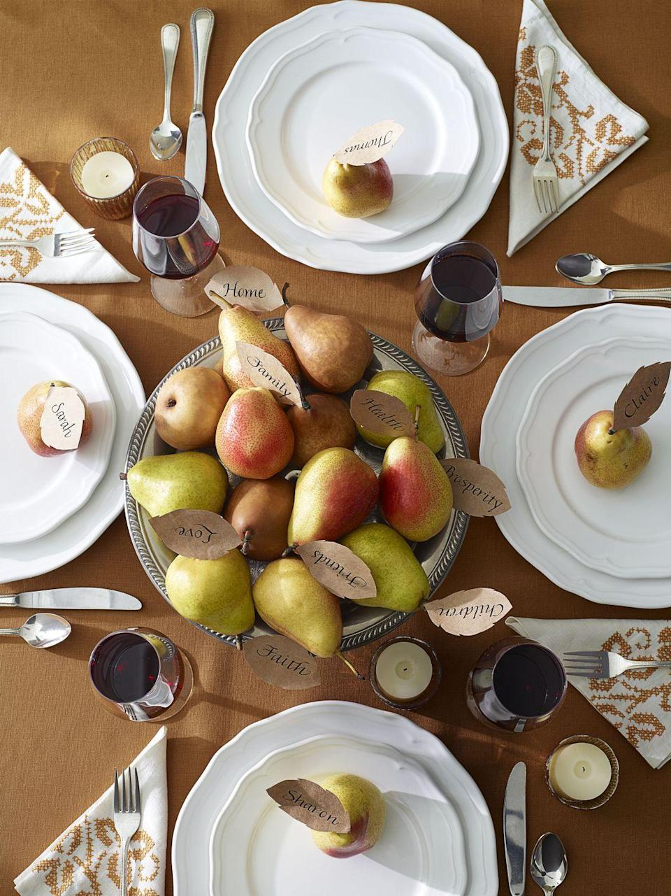 <p>Start off the celebration by asking family members to write down what they're grateful for on paper leaves. Once everyone's finished, stick them inside a bowl of pears to remind your dinner guests what the holiday is really about. </p>