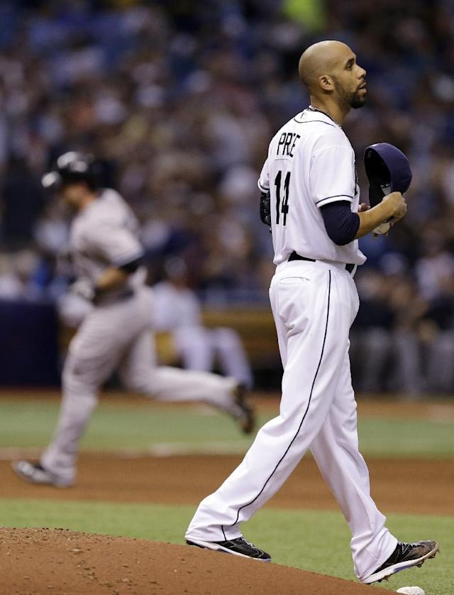 Tampa Bay Rays starting pitcher David Price (14) walks around the mound as New York Yankees' Brian McCann rounds the bases after hitting a home run during fifth inning of a baseball game on Thursday, April 17, 2014, in St. Petersburg, Fla. (AP Photo/Chris O'Meara)