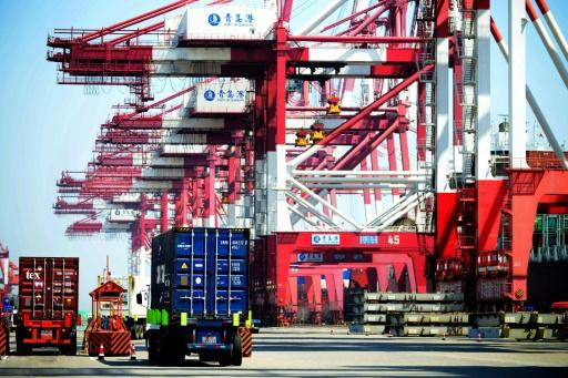 US trade deficit improves slightly in March