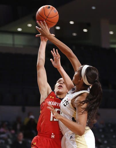 Maryland guard Chloe Pavlech, left, goes up for a shot while Georgia Tech center Shayla Bivins, right, defends during the first half of an NCAA college basketball game in Atlanta on Sunday, Jan. 20, 2013 (AP Photo/Josh D. Weiss)