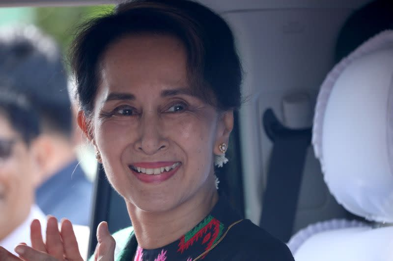 FILE PHOTO: Myanmar's State Counsellor Aung San Suu Kyi arrives at a school in Kawhmu